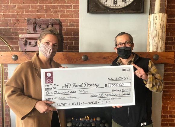 Grand Harbor Inn Makes $1,000 Donation to AIO Food Pantry